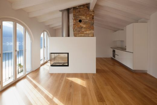 brown timber floors with warm fireplace at carpenters geelong